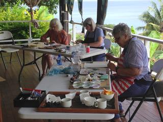 Students participate in a painting workshop on the deck at Daku Resort, Savusavu.
